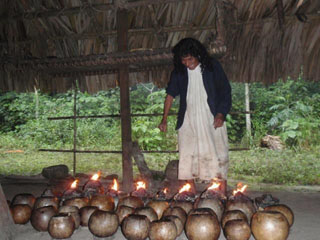 Don Antonio Lighting the Godpots